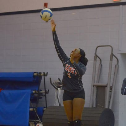 William Carey's Chassidy Harris serves during practice