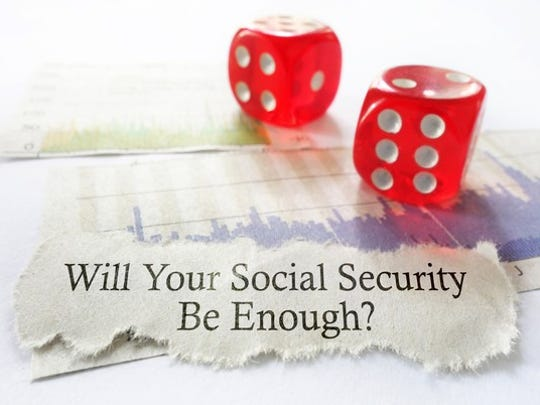 "Two red dice next to torn piece of paper on which is printed ""Will Your Social Security Be Enough?"""