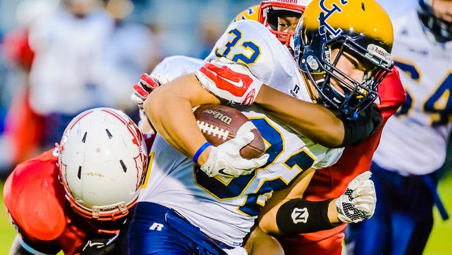 Cade Evert (32) and Grand Ledge are in a three-way tie atop the CAAC Blue standings.
