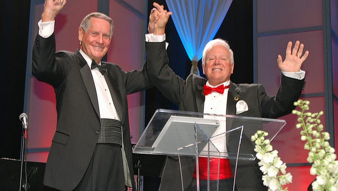 """Florida Institute of Technology Board of Trustees Chairman Phillip Farmer and President and CEO Anthony Catanese celebrate during the President's Gala to honor the successful conclusion of Florida Institute of Technology's """"Create The Future"""" capital campaign on April 23 at the Charles and Ruth Clemente Center on the Florida Tech campus."""