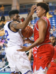 Delaware's Cazmon Hayes loses the ball to Delaware State's Joseph Lewis in the second half at the Bob Carpenter Center Friday.