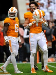 Tennessee running back Jalen Hurd (1) puts on his helmet