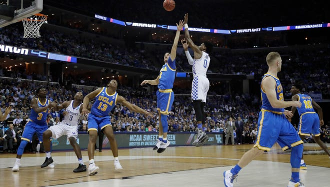 Kentucky guard De'Aaron Fox shoots against UCLA in the first half of a Sweet 16 game on Friday, March 24, 2017, at the FedExForum in Memphis.