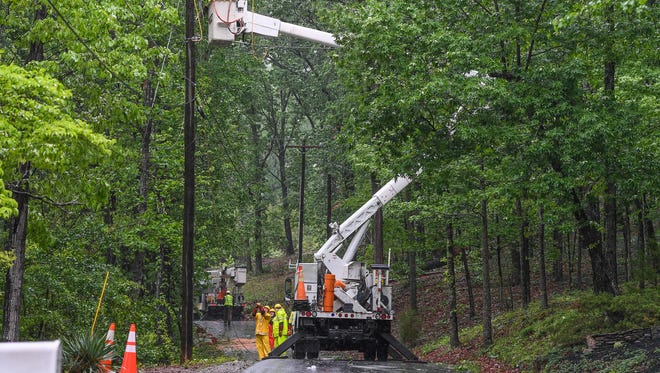 Duke Power workers repair power lines on Old Rockhouse Road near Paris Mountain on Monday, April 24, 2017. The lines was taken down after by a tree that fell due to the rain saturated ground.