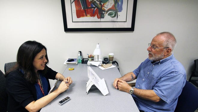 Kim Mueller administers a test to Alan Sweet, in which he describes an illustration. It was for a University of Wisconsin-Madison study on dementia.