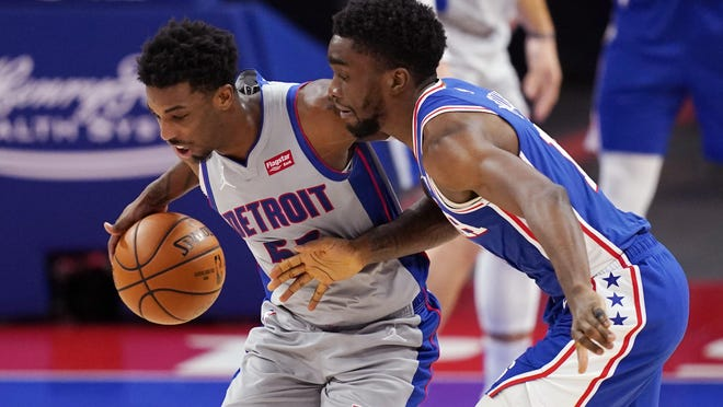 Detroit Pistons guard Delon Wright (55) steals the ball away from Philadelphia 76ers guard Shake Milton during the second half of an NBA basketball game, Monday, Jan. 25, 2021, in Detroit.