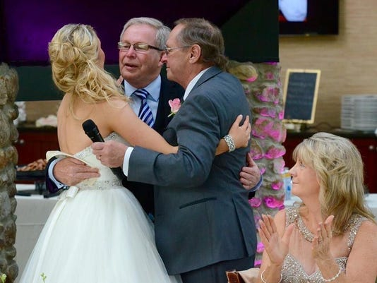 Ian Brown with Marissa and her father at reception