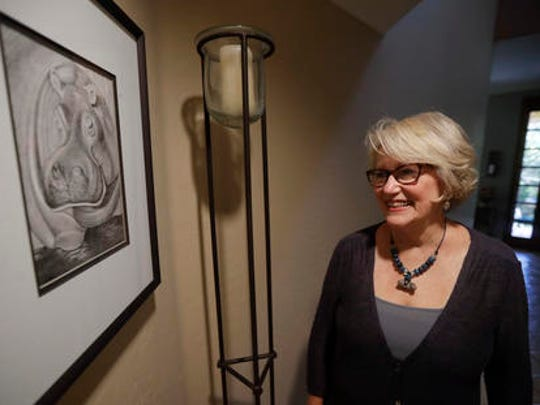"Gayla Peevey, singer of that enduring Christmas classic, ""I Want a Hippopotamus For Christmas,"" stands next to an image she drew of a hippopotamus in her home Wednesday, Dec. 14, 2016, in La Mesa, Calif.  It was 1953, and one of the hottest songs on the radio was   ""I Want a Hippopotamus For Christmas."" Now it's Christmas 2016, and Peevey is still singing. She leaves that to schoolchildren, ringtones, iTunes downloads and TV commercials that, to the 73-year-old singer's amazement, keep the song in everyone's head every Christmas season, whether they want it there or not ."