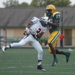 Harrison's Ovie Oghoufo gets ahold of Keenan Williamson's helmet instead of the football on a pass play.