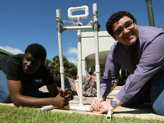 Jamal Carrol, 17, and Hunter Porter, 17, take part in the STEM@Work wrap-up session Wednesday at FGCU.