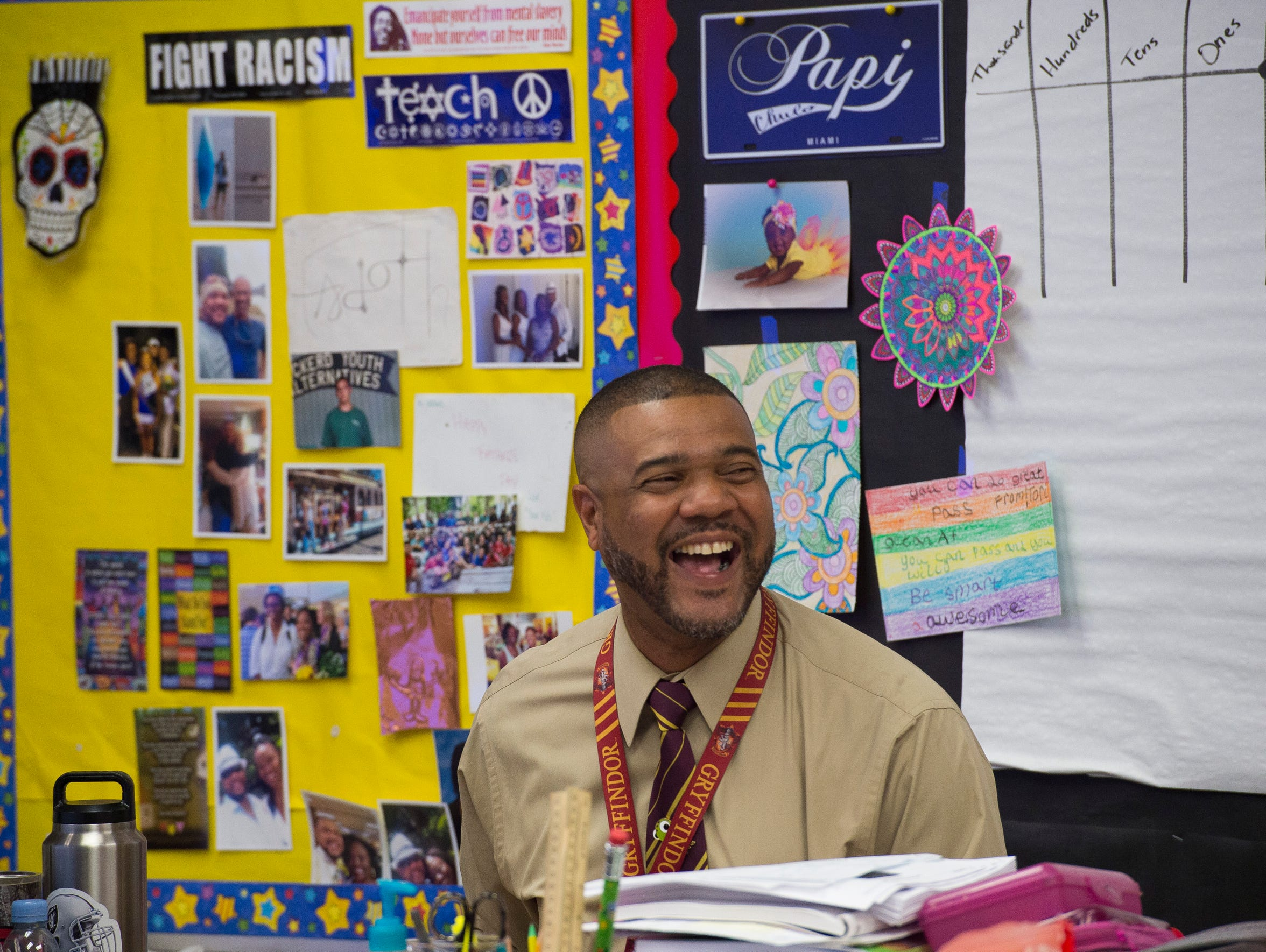 "Apollo Elementary School fourth-grade teacher Jonathan Hilliard, seen May 4 in his classroom in Titusville, has concerns about Florida's environment, teacher pay and school safety, but he is still hopeful for the future. ""I think what makes me feel hopeful about Florida is we can still write our story. Nothing's set in stone. We can make it as optimistic as we want,"" he said."
