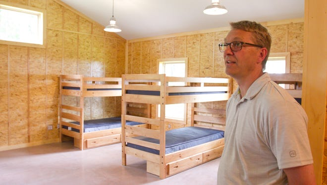 Doug Armstrong tours cabins at North Star Reach, a camp he founded for kids with serious medical issues, shortly before the camp opened, in this photograph taken June 15, 2016.