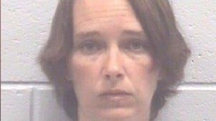 Christine Bays is charged with a felony for allegedly putting poison in a coworker's water.