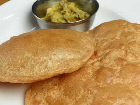 Maya's South Indian Cuisine in downtown Reno's West Street Market featuers puffy pillowy poori fried bread paired with potato masala.