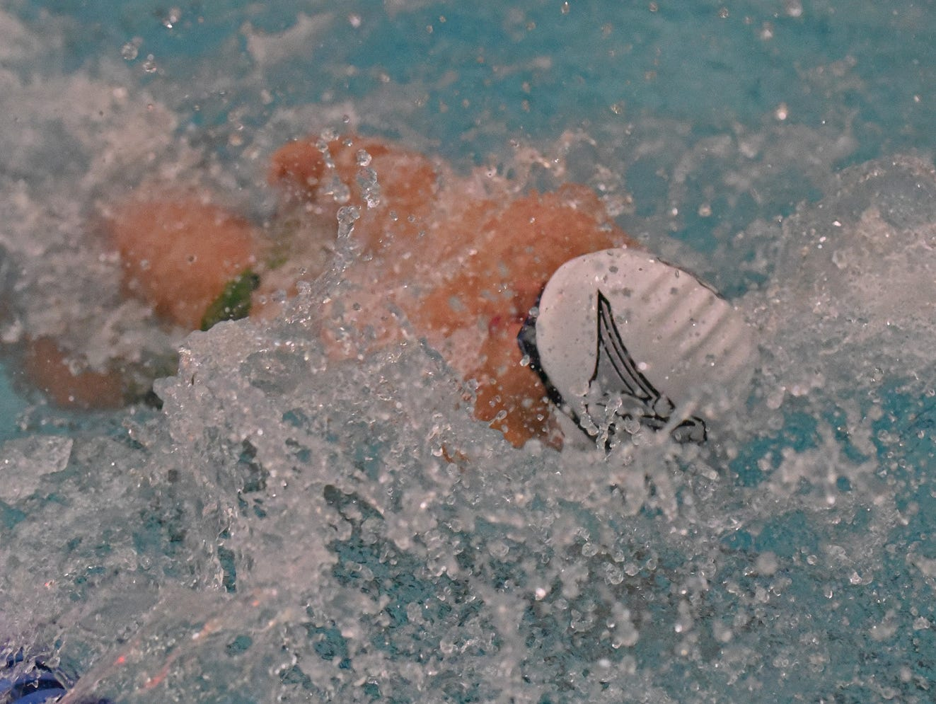 Fossil Ridge sophomore Danny Kovac, who set a school record in the 100-yard butterfly and also won the 100-yard backstroke, competes in the 200 medley relay in Thursday's City Meet at Edora Pool Ice Center. Fossil Ridge swept the three relays and won the team title.