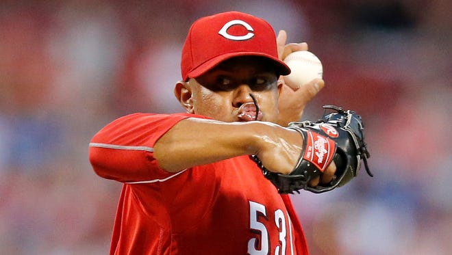 Cincinnati Reds relief pitcher Wandy Peralta (53) delivers a pitch in the top of the seventh inning against the Los Angeles Dodgers at Great American Ball Park on Friday, June 16, 2017.