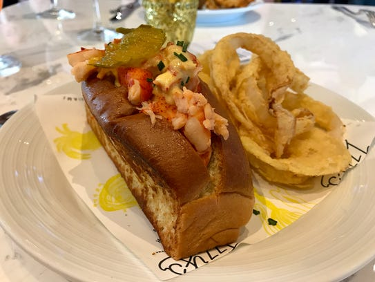 A warm lobster roll with onion rings from Izzy's Fish