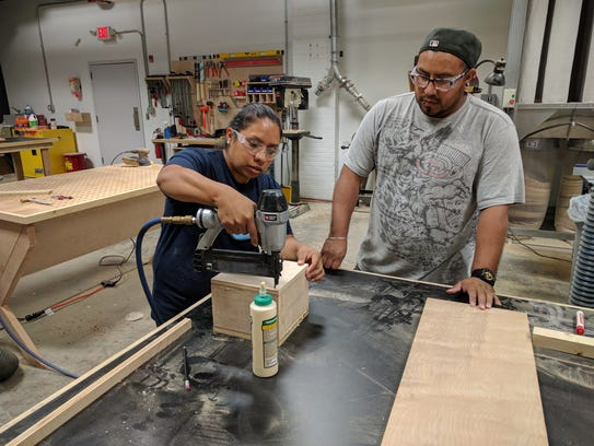 Monica Lopez, left, learns to use shop tools at Wilmington's