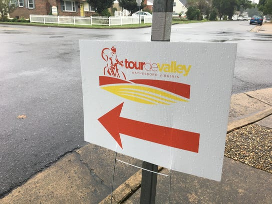 A rain-slicked sign for the Tour de Valley bike ride