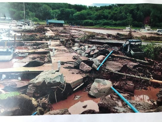 The floodwaters decimated the parking lots, slips and