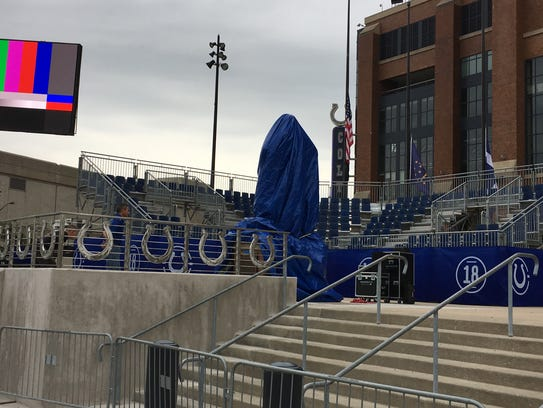 The Peyton Manninng statue sits out on W South St.