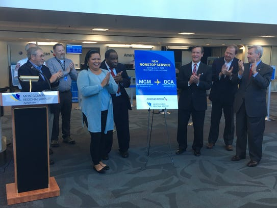 Officials applaud the announcement of direct flights