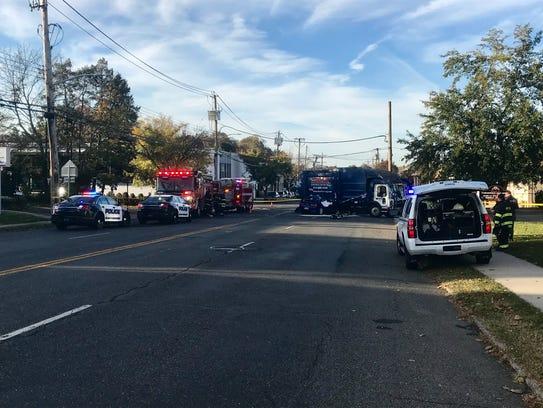 Police investigate a crash involving a car and a garbage