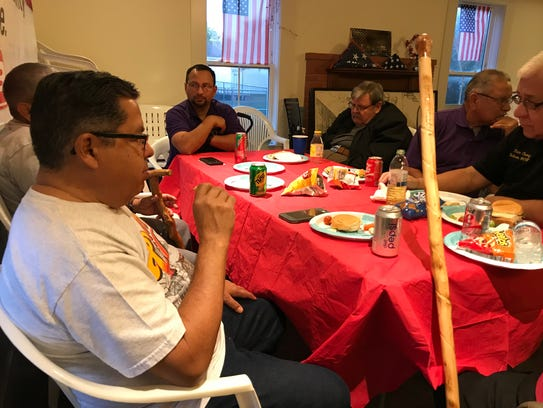 Military veterans eat while they talk about the Christmases