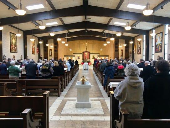 St. Lambert Catholic Church filled Thursday, Jan. 11,