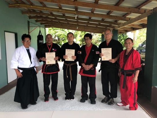 Three Arnis martial arts students passed their exams