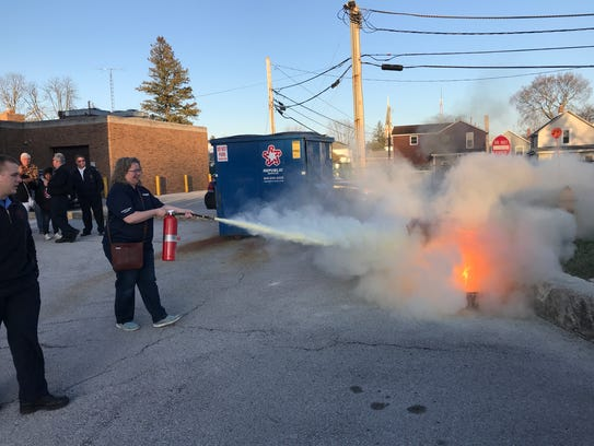 Lynette Kirsch extinguishes a fire during during Thursday's