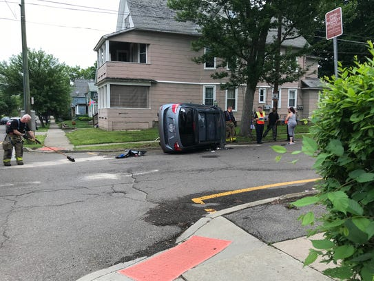A car overturned after crashing into another vehicle
