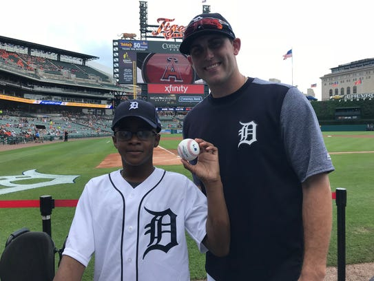Dakarai Moore II, left, poses with Matthew Boyd before throwing the ceremonial first pitch on Thursday.