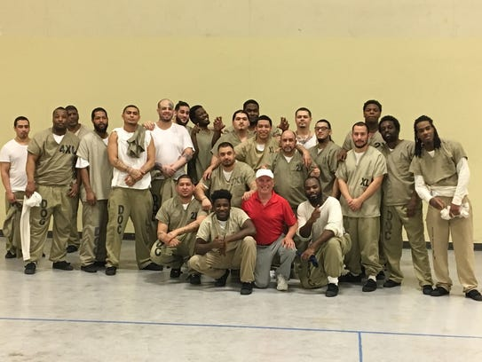 Prisoners from Cook County Jail pose wit pickleball