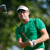 Robert Allenby of Australia follows his drive off the 18th tee during the first round of the Sony Open in Honolulu, in this file photo taken Jan. 10, 2013.