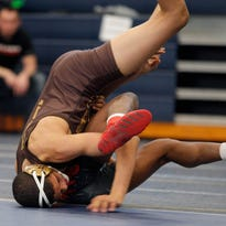 From rags to riches, Holt senior Deondre Yarber becomes unlikely state wrestling qualifier
