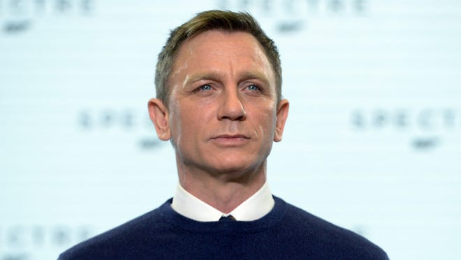 Daniel Craig poses during photocall for Bond movie 'Spectre.'