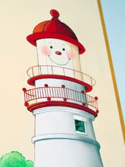 A smiley depiction of Marblehead Lighthouse is part