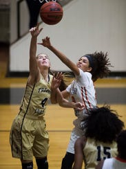 Lincoln Park Academy's Christen McCann, battling Treasure Coast's Mya Williams for a rebound during a Jan. 8, 2018 game in Fort Pierce, is averaging 15.1 points per game through 20 games.