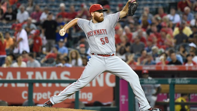 Cincinnati Reds starting pitcher Dan Straily (58) delivers a pitch during the first inning against the Los Angeles Angels at Angel Stadium of Anaheim.