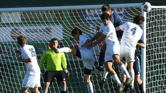 West Shore and Berkeley Prep players vie for control of the ball in front of the Berekley net during Thursday's Class 2A championship in Deland.