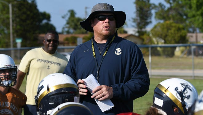 Eau Gallie head football coach Tim Powers talks with his team during practice at Eau Gallie High School.
