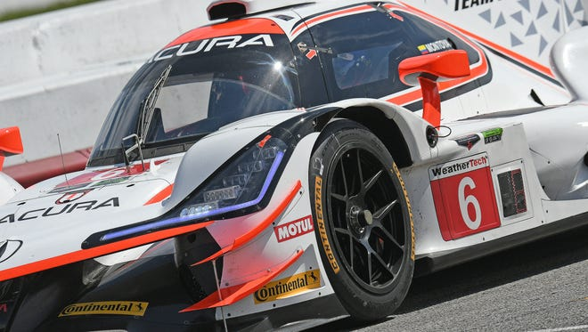 Acura Team Penske took first and second place at the Acura Sports Car Challenge at Mid-Ohio on Sunday.