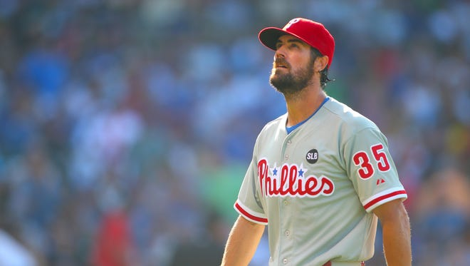 Jul 25, 2015: Philadelphia Phillies starting pitcher Cole Hamels (35) walks off the field after the eighth inning against the Chicago Cubs at Wrigley Field.