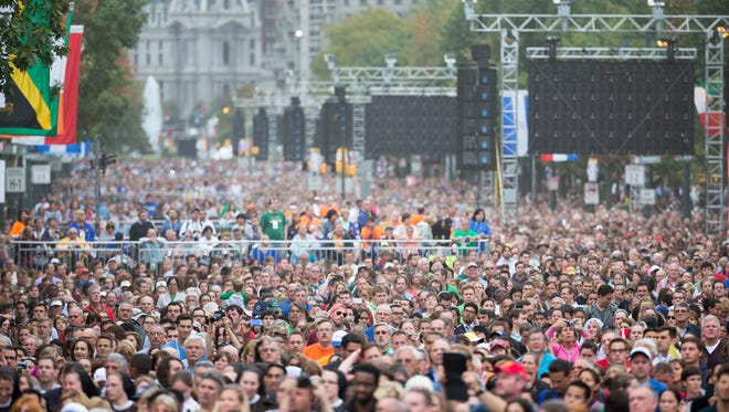 Crowds gather to watch Pope Francis celebrate Mass at the Benjamin Franklin Parkway in Philadelphia on Sept. 27, 2015.