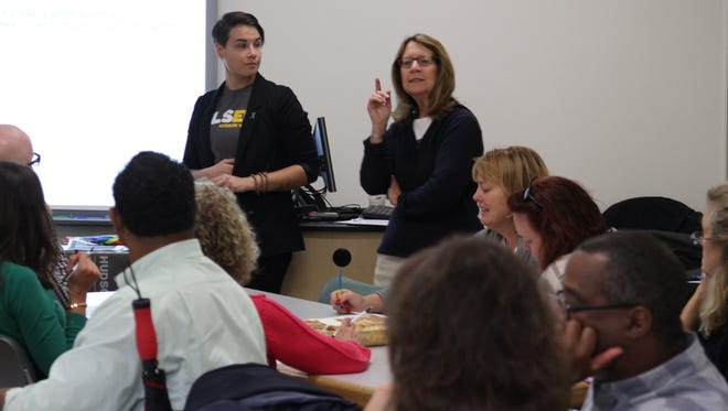 Mary Jane Karger, right, and Shep Verbas, left, speak to local educators on how to better understand transgender students.