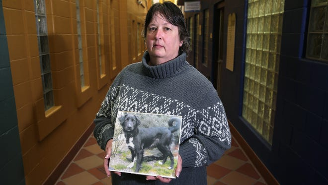 Vicki Prey, Outagamie County Humane Officer, holds the likeness of a dog that was found strangled in September. The Fox Valley Humane Association is looking for information to help their investigation.