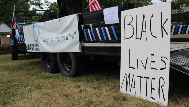 Members of the community gathered at Rausch Park on Second Street in Fremont for a Black Lives Matter rally on Saturday.