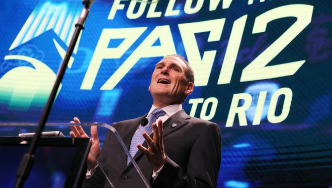 Pac-12 commissioner Larry Scott speaks at the Pac-12 NCAA college football media day in Los Angeles Thursday, July 14, 2016.