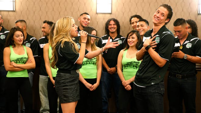 """El Pasoan Elia Esparza, a recent contestant on """"The Voice"""" singing competition, serenades El Paso Coyotes forward Gary Willis during the team's news conference Wednesday afternoon at the Hilton Garden Inn El Paso Airport location. On Saturday, Willis and the team will be in Dallas for the team's first game against the Sidekicks."""